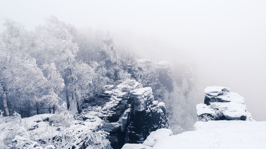 EyeEmNewHere Whiteout Beauty In Nature Cold Temperature Day Fog Frozen Mountain Nature No People Outdoors Scenics Sky Snow Tranquil Scene Tranquility Tree Water Weather Winter