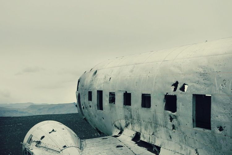 Abandoned Airplane On Field Against Sky