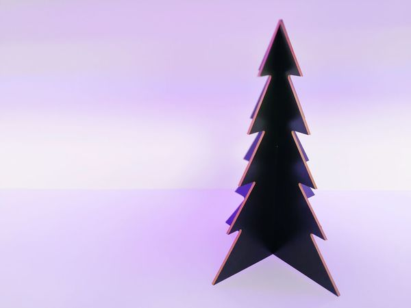 Triangle Shape Christmas Tree Colored Background Christmas No People Indoors  Studio Shot Christmas Decoration Neutral Tradition Celebration Single Object Backround Free Space For Text Background