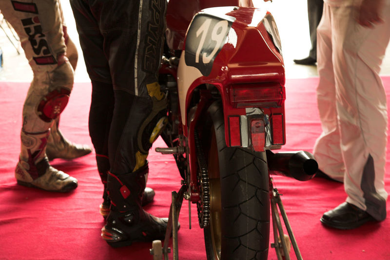 Bikers world, competition and Bikers garage Adult Adults Only Bike Bike Race Bikerace Bikers Competition Day Garage Human Body Part Human Leg Leather Leatherboots Low Section Motorbike Motorcycle Motorsport People Race Red Repair Sport Standing Two People Wheel