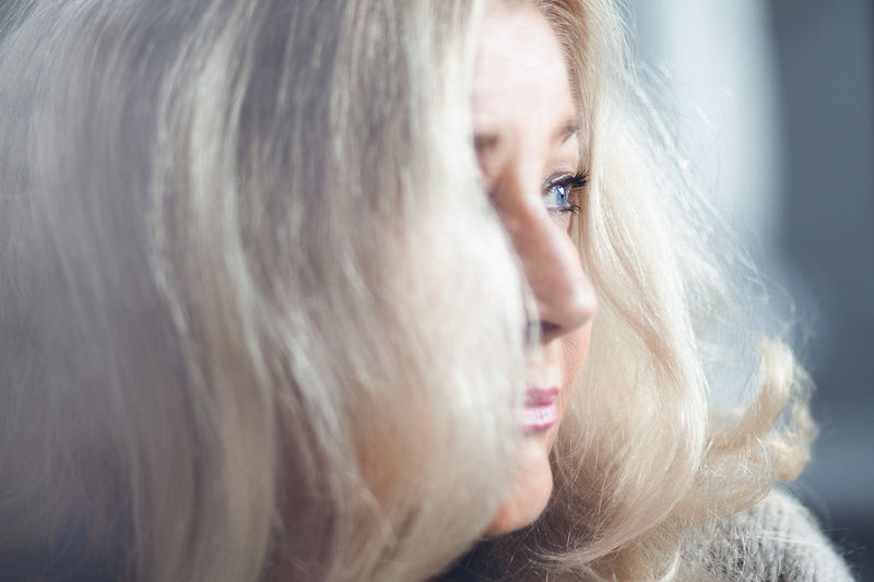 Close-up of thoughtful woman with gray hair