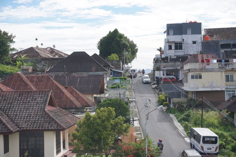 One of the street in Bukit Tinggi, Padang, West Sumatera, Indonesia No People Street Padang Padang, Indonesia Bukit Tinggi West Sumetra Bukit Tinggi, Indonesia Town Cloud - Sky Sky Architecture City Built Structure West Sumatera Roof Top Of The Hotel Roof Top View