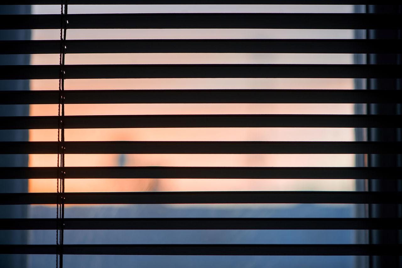 Full Frame Shot Of Window Blinds During Sunset
