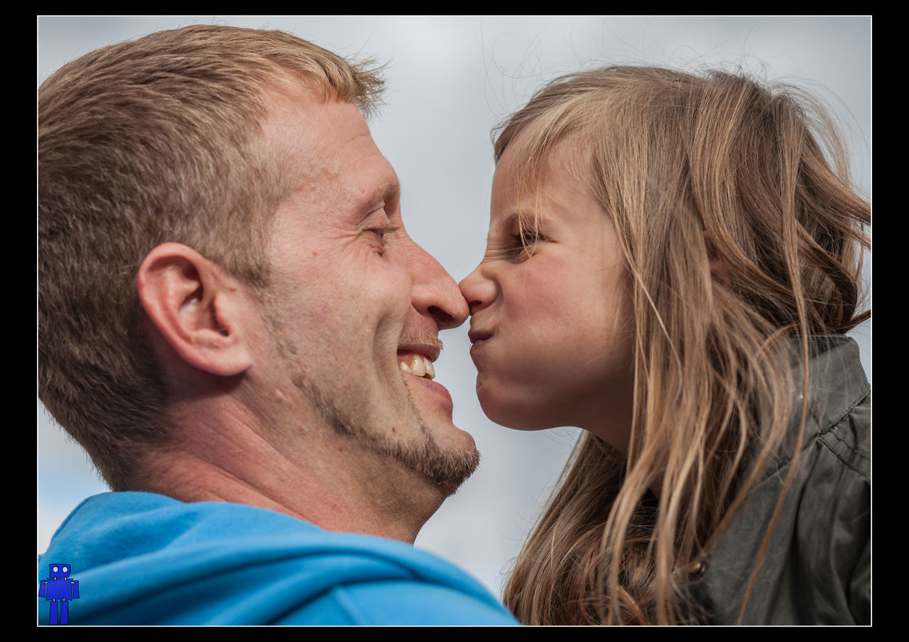 love, togetherness, two people, face to face, bonding, kissing, real people, headshot, happiness, childhood, close-up, indoors, smiling, blond hair, day, men, people
