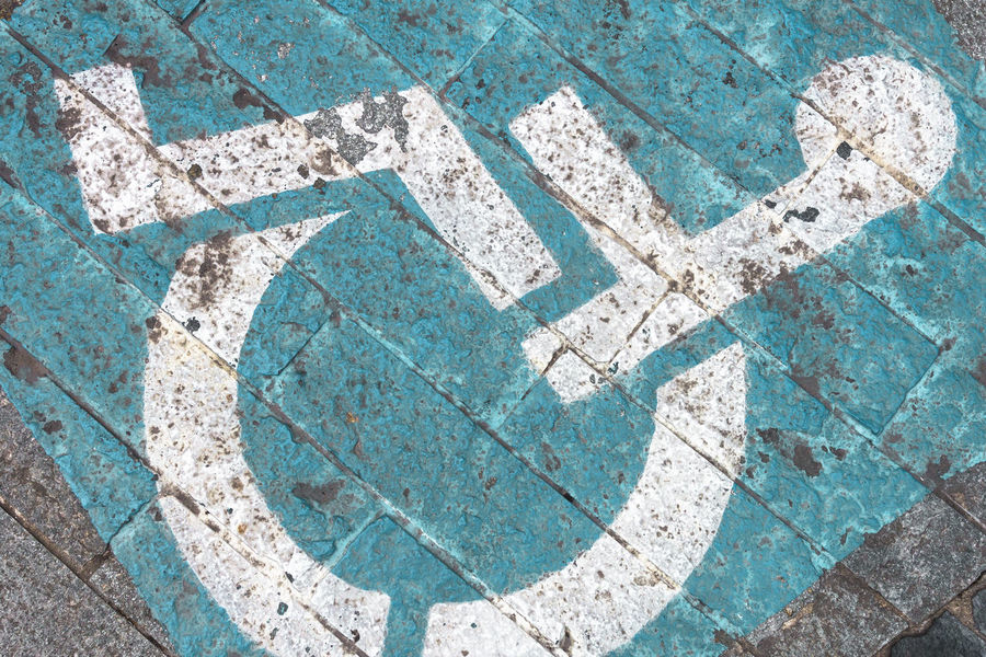 Disability symbol painted on the floor Asphalt Care Icon Invalid  Paint Road Sign Traffic Access Azure Backgrounds Blue Disability  Disabled Grunge Handicap Handicapped Medical Parking People Permit Reserved Space Street Symbol