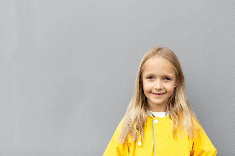 Kid in yellow raincoat  colors of the year 2021 ultimate gray and illuminating