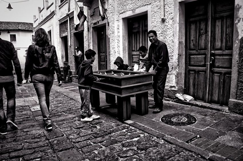 Father playing with his children. Streetphotography Street Photography Streetphoto_bw Blackandwhite Monochrome Black And White Father Playing Kids Tablesoccer Games Snapseed Quito Equador