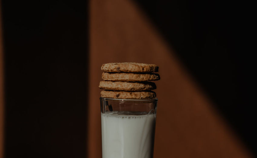 Close-up of cookies in glass on table