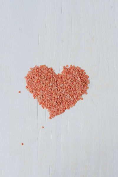 Love. Vegan food/diet. Heart shape made with red split lentils over white wooden table. Abstract Close-up Concept Conceptual Conceptual Photography  Diet Directly Above Fit For Life Getting In Shape Heart Ideas Life Love Loving Natural Shape Simplicity Slimming Still Life Symbol Valentine's Day  Vegan Vegan For Fit Vegetarian Wholefoods