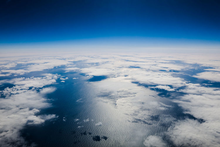 Cloud - Sky Sky Aerial View Cloudscape Planet Earth Space Blue Nature Scenics - Nature Atmosphere Environment High Up Planet - Space Satellite View Meteorology Urban Skyline High Angle View Horizon No People Above Outdoors Dark Blue Wind Softness