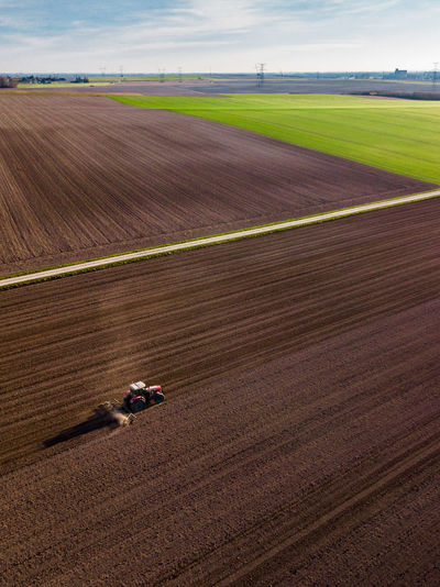 Aerial view of combine harvester on agricultural field