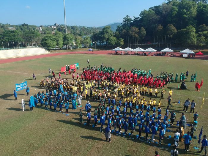 sports day at stadium Battle Cry Army Sport Sports Day  School School Sports Sunny Day Morning Blue Green Red Yellow Stadium Dash Runner Military Parade Men Military Uniform Military Army Soldier Uniform Marching Tree Army Parade