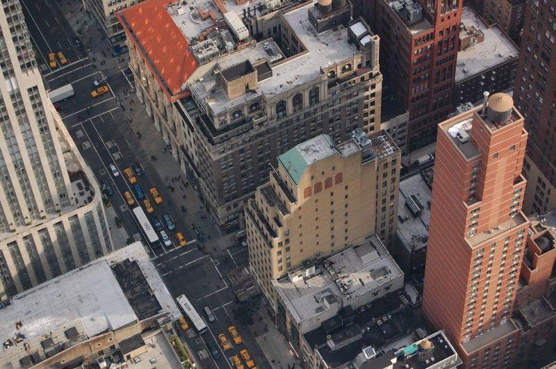 2011 Top of the Empire State Building Aerial View Architecture Building Building Exterior Built Structure Car City City City Life Low Angle View Modern Office Building Perspective Residential Structure Skyscraper Street Streetphotography Tall Tall - High Top Perspective Tower Urban Urbanphotography Window