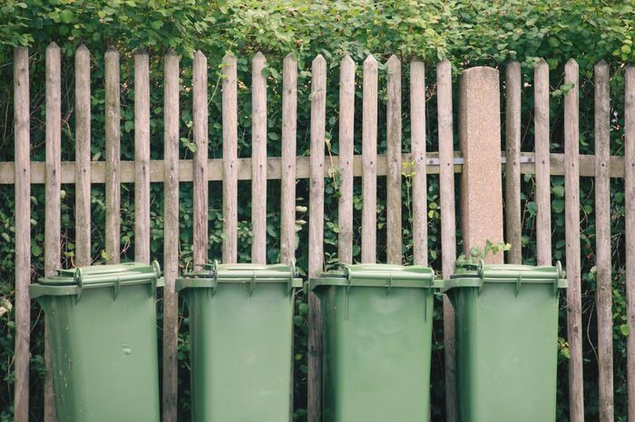 Trashcans Green Trashcans In A Row Wooden Fence Tree EyeEm Selects Protection Green Color