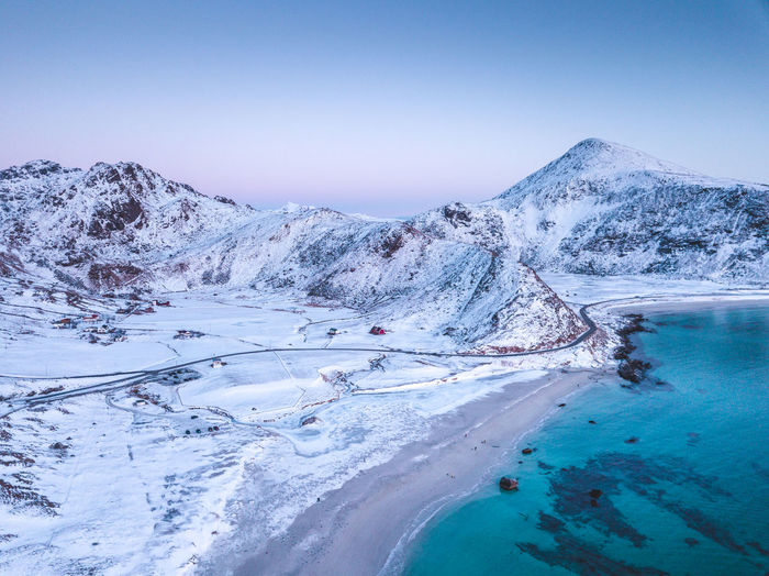 Haukland beach at the sunset Scenics - Nature Beauty In Nature Water Sky Mountain Tranquility Tranquil Scene Cold Temperature Nature Winter Environment Idyllic Non-urban Scene Snow No People Day Landscape Blue Outdoors Snowcapped Mountain Power In Nature Norway Lofoten Beach Island
