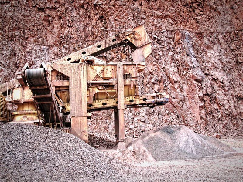 stonecrusher machine in an open pit mine. mining industry Excuvator Open Pit Mine Mining Mine Bergbau Pit Quarry Steinbruch Steinbrecher Stone Crusher