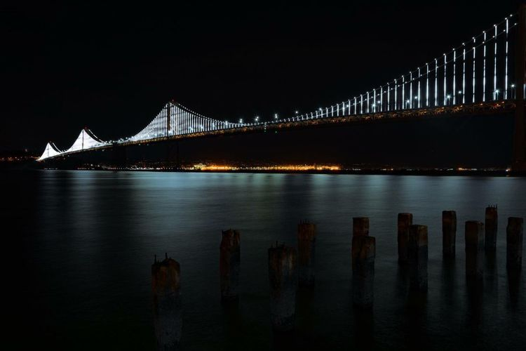 Bay Bridge in San Francisco, Ca. Architecture City Night Travel Destinations Built Structure Illuminated Bridge - Man Made Structure Outdoors Water Architecture California Love California No People Sea Tourism Reflection Engineering Connection Suspension Bridge Low Angle View San Francisco Bay Bridge Transportation