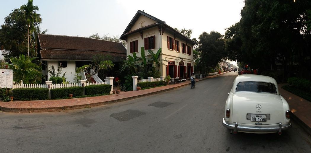 South East Asia Architecture Building Building Exterior Built Structure Car City Day House Land Vehicle Laos Luang Prabang Mode Of Transportation Motor Vehicle Nature No People Outdoors Plant Road Sky Street Transportation Tree