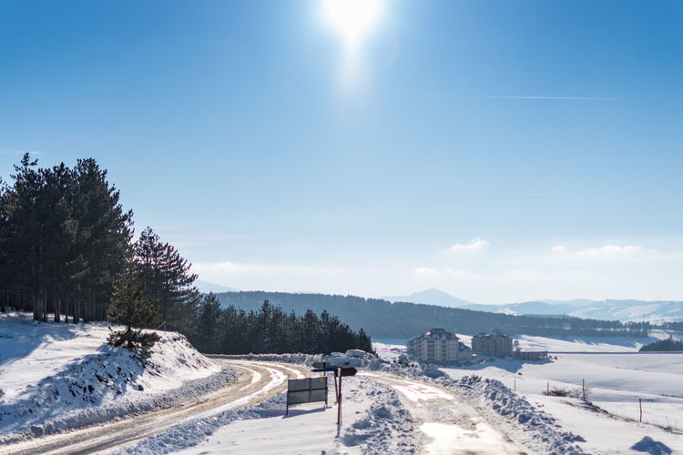 Snow Cold Temperature Winter Sky Scenics - Nature Beauty In Nature Sunlight Tree Nature Plant Mountain Day Landscape Environment Tranquil Scene Tranquility No People Non-urban Scene White Color Sun Snowcapped Mountain Outdoors Lens Flare