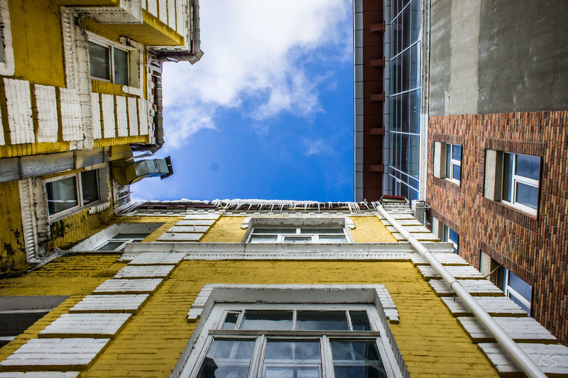 Architecture Balcony Building Building Exterior Built Structure Cloud - Sky Day House Low Angle View No People Outdoors Residential Building Sky Window Yellow