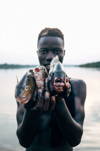 Close-up of man holding fish