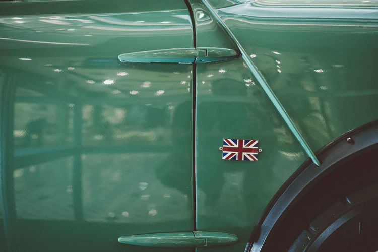 Close-Up Of British Flag On Green Car