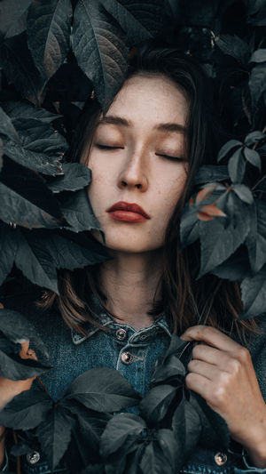 Close-up of beautiful young woman with eyes closed