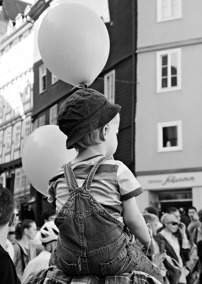 Architecture Balloon Boys Building Exterior Child Childhood Children Only City Day Fun Helium Balloon Monochrome Photography One Boy Only One Person Outdoors People Real People Sitting On Shoulders