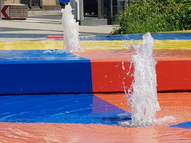 City Fountain - Mülheim Ruhr Blue Red Yellow City Centre Northrhine Westphalia Well  Fountain Mülheim An Der Ruhr Mülheim (Ruhr) Mülheim City Marketing Tourism Close Up Zoom Centered Perspective Copy Space Travel Travel Destinations Marketing Parallel Horizontal Composition Horizontal Water Spraying Multi Colored Blue Cleaning Equipment Red Architecture Close-up