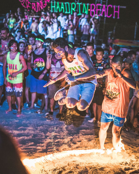 Skilled Jumper Group Of People Crowd Large Group Of People Real People Burning Men Fire Night Motion Flame Outdoors Skipping Jump Jumping Colorful Colors Neon Neon Colored Neon Sign Thailand Thailand_allshots Shorts Burning Skill  Enjoyment