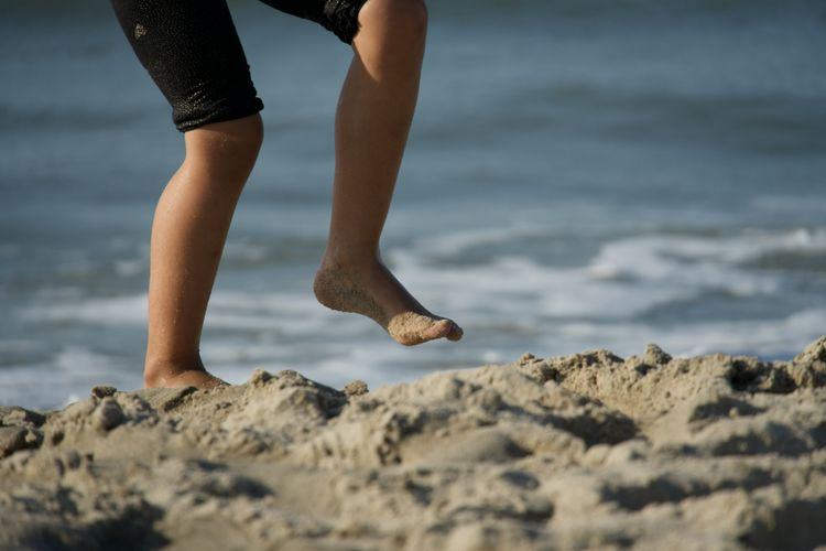 Child dancing on the beach