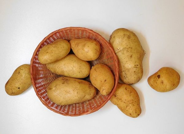 Potatoes on white background Basket Close-up Day Food Food And Drink Freshness Healthy Eating Indoors  No People Prepared Potato Raw Potato Studio Shot White Background
