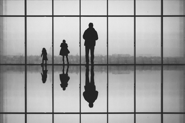 Family Against Glass Window At Centre Pompidou-Metz