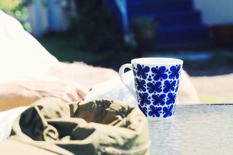 Close-up of bean bag and mug on table