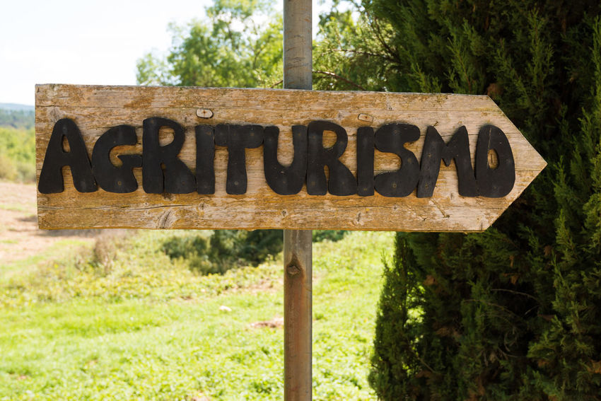 Handmade wooden agriturismo sign in Tuscany - agritourism is a typical concept of bed and breakfast in a farming environment in Italy. Italia Agritourism Agriturism Agriturismo Close-up Communication Day Guidance Italian Food Italy Italy❤️ Nature No People Outdoors Single Word Text Tree