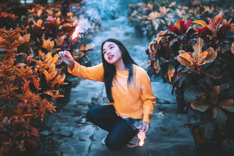 Long live all the magic we made. Woman holding sparklers. Celebration Holiday Light Lights Night Lights Nightphotography Sparkle Sparkler Autumn Beautiful Woman Beauty In Nature Flower Flowering Plant Leaf Leaves Lifestyles Light And Shadow Magic Nature Night Orange Color Portrait Real People Sparkles Vintage
