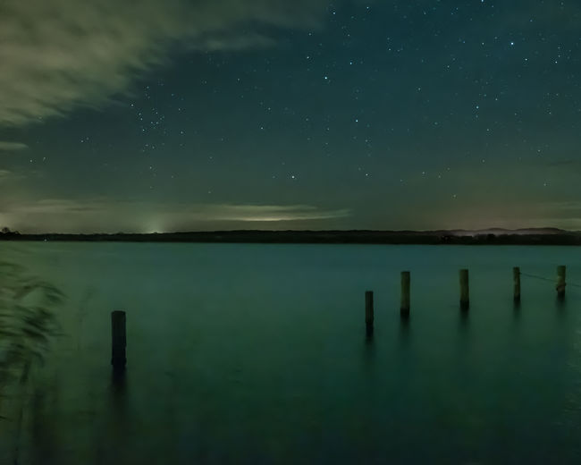 Night at the lakeside. I tried to get some falling stars of the Leonids, but there were many clouds. I only saw one but it was not in frame. Fresh On Eyeem  Ratzeburger See Schleswig-Holstein Astronomy Beauty In Nature Blurred Motion Clouds Galaxy Germany Horizon Over Water Lake Nature No People Outdoors Reed Scenics Sky Sky Full Of Stars Star - Space Tranquil Scene Tranquility Water Wide Angle