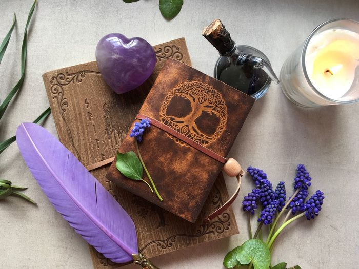Witch table Candle Muscari Witchcraft  Witch Magic Magic Book High Angle View Still Life Purple No People Indoors  Personal Accessory Flowering Plant Flower Close-up Art And Craft Nature Multi Colored Plant Table