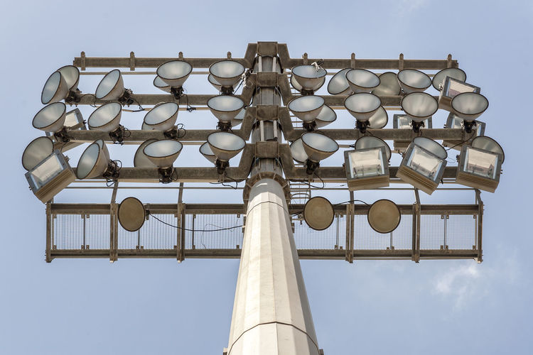 Low angle view of lighting equipment against sky