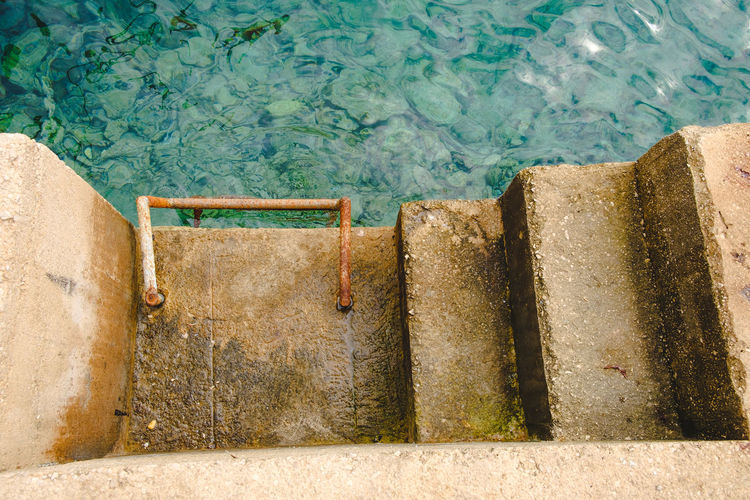 By the sea Rock Absence Aqua Blue Clean Concrete Concrete Steps Day High Angle View Ladder Nature No People Outdoors Sea Sea Mood Staircase Steps And Staircases Swimming Texture Travel Travel Destinations Water Yellow
