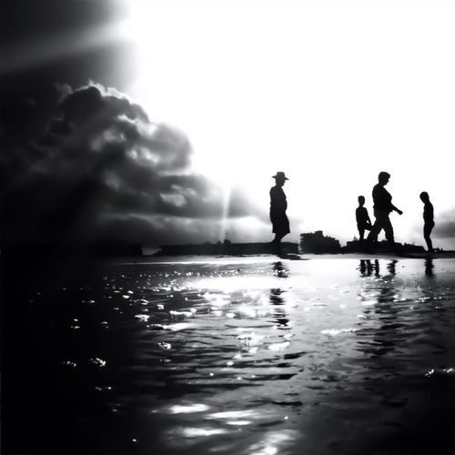 Silhouette people in swimming pool