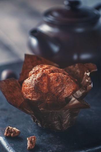 chocolate cupcakes and nuts on wooden background close up Food And Drink капкейк шоколадныы домашняя вы кекс кекс с чайник лишний вес Food Indoors  Brown Focus On Foreground Close-up Selective Focus перекус