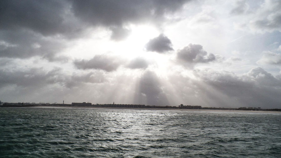 Water Sky Cloud - Sky Scenics - Nature Beauty In Nature Waterfront Tranquility Sea Tranquil Scene Sunbeam No People Day Nature Non-urban Scene Idyllic Sunlight Outdoors Storm Ominous Streaming