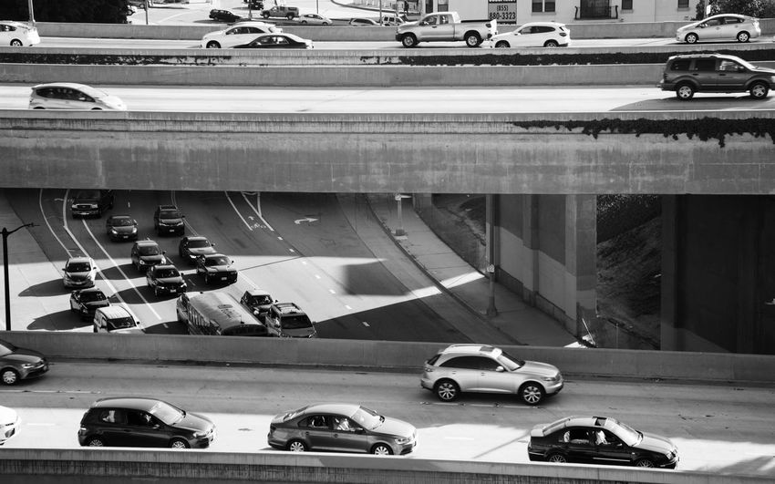 High Angle View Of Cars On Elevated Road Over Highway