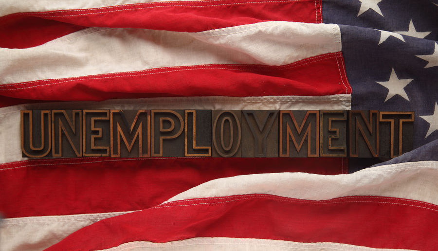The word unemployment in old wood type on a USA flag American Flag Cloth Culture Fabric Font Jobs Laid Off Letters Natural Light No People Out Of Work Red White And Blue Social Issues Stars And Stripes Type Typography Unemployment United States Flag  USA Vintage Flag Welfare Wood Type Working