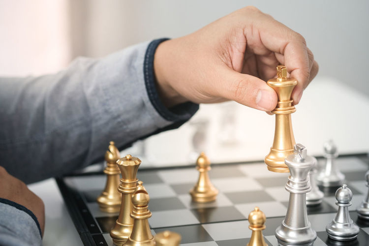 Businessman play with chess game. success management concept of business strategy and tactic challenge Chess Business Game Strategy Businessman Intelligence Board Competition Play Move Challenge Leadership Concept Chessboard King Success Queen Power Hand Piece Man Black Victory Win Leisure White Battle Player Pawn Checkmate Strategic Background Table Wood Planning Think Check Set Match Knight  Concentration Decision Wooden Fight person Competitive People Adult Conflict Winner Board Game Human Hand Human Body Part Leisure Activity Leisure Games Chess Piece Relaxation One Person Real People Indoors  Holding Close-up Focus On Foreground Body Part Finger Queen - Chess Piece