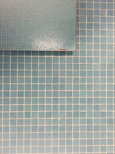 Tiled blue wall in bathroom