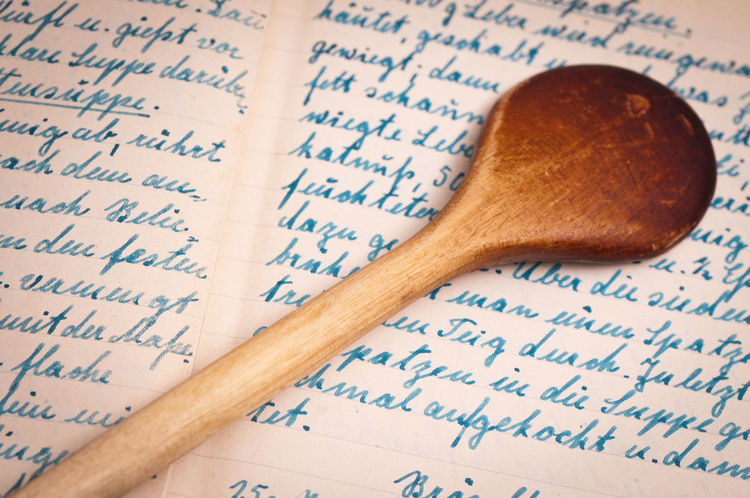 Wooden spoon and handwritten old recipe Spoon Arts Culture And Entertainment Book Close-up Communication Cookbook Education Food Handwritten Indoors  Literature Musical Note No People Page Paper Recipe Sheet Music Text Wood - Material Wooden Spoon