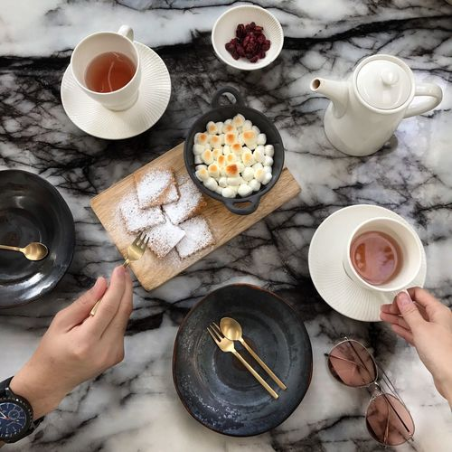 Human Hand Human Body Part Drink Holding Food And Drink Coffee - Drink Tea - Hot Drink High Angle View One Person Real People Refreshment Teapot Milk Directly Above Bowl Breakfast Food Lifestyles Indoors  Freshness