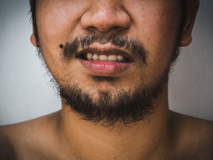 close up detail of asian male mouth have beard and mustache Beard Male Mouth Mustache Man Face Caucasian Handsome Adult Facial Black Guy Hipster Close Closeup Bearded Model Up Fashion Portrait Background Lifestyle Hair Stylish Attractive Expression Modern HEAD person Cool Serious Shirt Style Young Beautiful Long Masculine Men Vintage Artistic Eyes Smiling Casual Posing Growth Retro Moustache Smile Dramatic Asian